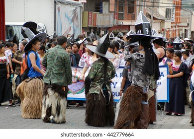 "COTACACHI, ECUADOR - JUNE 23, 2016: Inti Raymi, the Quechua solstice festival, children's parade.  Group of teen aged boys march to ""take the square."""