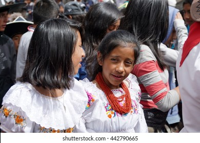 COTACACHI, ECUADOR - JUNE 23, 2016: Children's parade in Inti Raymi, the Quechua solstice celebration.  Young women in traditional dress dance in the procession.