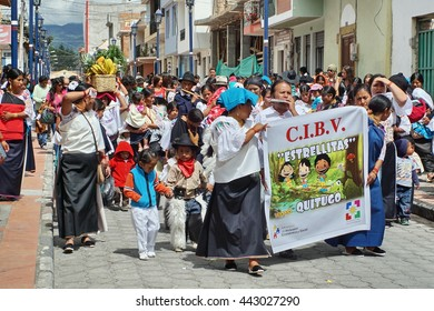 COTACACHI, ECUADOR - JUNE 23, 2016: Children's parade in Inti Raymi, the Quechua solstice celebration.  Pre-school group marches into the square.