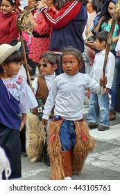 COTACACHI, ECUADOR - JUNE 23, 2016: Children's parade for Inti Raymi, the Quechua solstice celebration.  Costumed children stomp and dance to wake up Mother Earth.