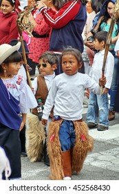 COTACACHI, ECUADOR - JUNE 23, 2016: Children parade on the first day of Inti Raymi, the Quechua solstice celebration.  Children march and dance to awaken Mother Earth.