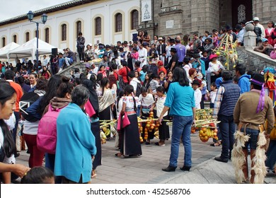 COTACACHI, ECUADOR - JUNE 23, 2016: Children parade on the first day of Inti Raymi, the Quechua solstice celebration.  Children march past the reviewing stand with offerings.