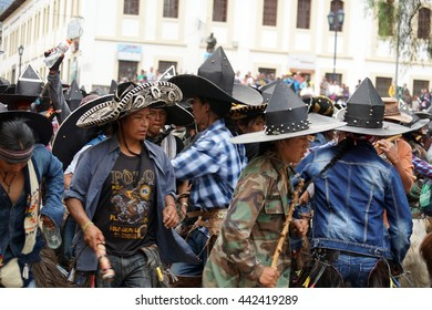 COTACACHI, ECUADOR - JUNE 24, 2016: Inti Raymi, Quechua solstice celebration, with a history of becoming violent in Cotacachi.  Men march in circles, stomping.