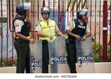 COTACACHI, ECUADOR - JUNE 24, 2016: Inti Raymi, the Quechua solstice celebration, with a history of violence in Cotacachi.  Police with riot shields are present to control clashes.