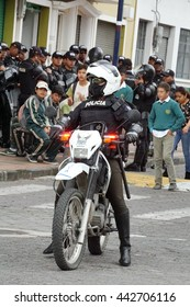 COTACACHI, ECUADOR - JUNE 24, 2016: Inti Raymi, the Quechua solstice celebration, with a history of violence in Cotacachi.  Police on motorbikes lead the groups in and out of town.