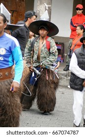 COTACACHI, ECUADOR - JUNE 24, 2017: Men's parade in Inti Raymi, the indigenous solstice celebration, with a history of violence in the village