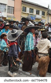 COTACACHI, ECUADOR - JUNE 24, 2017: Boys march ahead of the men's parade in Inti Raymi, the indigenous solstice celebration, with a history of violence