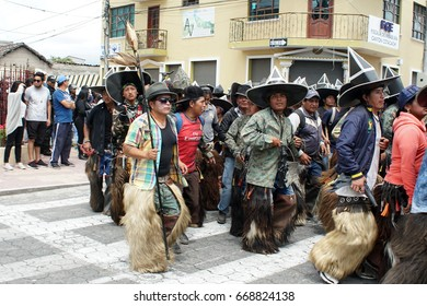 COTACACHI, ECUADOR - JUNE 24, 2017: Men's parade in Inti Raymi, the indigenous solstice festival, with a history of violence in the village