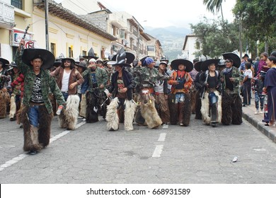 COTACACHI, ECUADOR - JUNE 24, 2017: Men's parade in Inti Raymi, the indigenous solstice celebration, with a history of violence