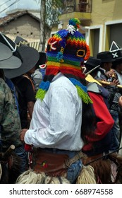 COTACACHI, ECUADOR - JUNE 24, 2017: Man in a devil mask in the men's parade in Inti Raymi, the indigenous solstice celebration, with a history of violence in the village