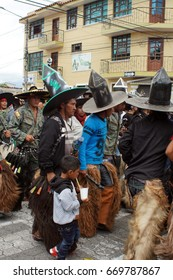 COTACACHI, ECUADOR - JUNE 24, 2017: Men's parade at Inti Raymi, the indigenous solstice festival, with a history of violence in the village
