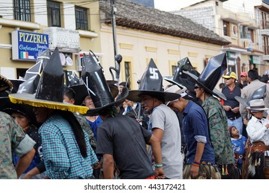 """COTACACHI, ECUADOR - JUNE 25, 2016: Inti Raymi, the Quechua solstice celebration, with a history of violence in Cotacachi.  Men line up to rush forward and """"take the square."""""""
