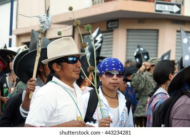 COTACACHI, ECUADOR - JUNE 25, 2016: Inti Raymi, the Quechua solstice celebration, with a history of violence in Cotacachi.  Men stomp and dance in the park to wake up Mother Earth.