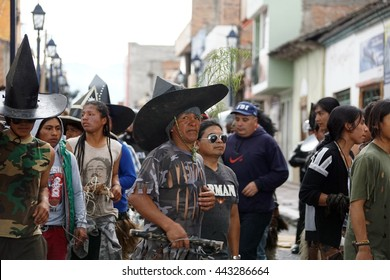 COTACACHI, ECUADOR - JUNE 25, 2016: Inti Raymi, the Quechua solstice celebration, with a history of violence in Cotacachi.  Men stomp and dance in a circle to awaken Mother Earth.