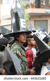COTACACHI, ECUADOR - JUNE 25, 2016: Inti Raymi, the Quechua solstice celebration, with a history of violence in Cotacachi.  Costumed men stomp and dance to wake up Mother Earth in the square.