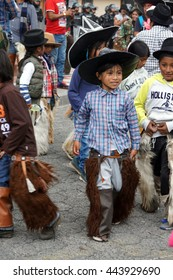 COTACACHI, ECUADOR - JUNE 25, 2016: Inti Raymi, the Quechua solstice celebration, with a history of being violent in Cotacachi.  Children march and dance ahead of the men.