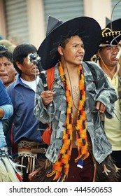 "COTACACHI, ECUADOR - JUNE 25, 2016: Inti Raymi, the Quechua solstice celebration, with a history of violence in Cotacachi.  Men march to ""take the square."""
