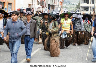 COTACACHI, ECUADOR - JUNE 25, 2017: Men's parade at Inti Raymi, the indigenous solstice festival with a history of violence in the village