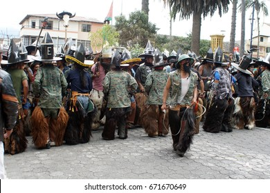 COTACACHI, ECUADOR - JUNE 25, 2017: Men's parade for Inti Raymi, the indigenous solstice festival, with a history of violence in the village