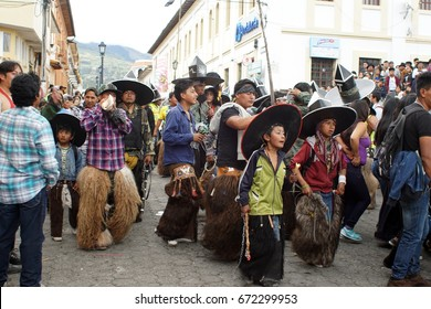 COTACACHI, ECUADOR - JUNE 25, 2017: Children participate in the men's parade at Inti Raymi, the indigenous solstice festival, with a history of violence in the village