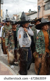 COTACACHI, ECUADOR - JUNE 25, 2017: Men's parade at Inti Raymi, the indigenous solstice festival, with a history of violence in the village
