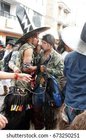 COTACACHI, ECUADOR - JUNE 25, 2017: Men's parade in Inti Raymi, the indigenous solstice festival, with a history of violence in the village