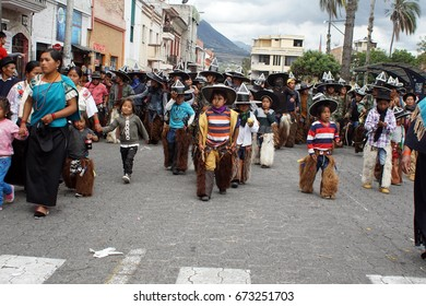 COTACACHI, ECUADOR - JUNE 25, 2017: Children in the men's parade in Inti Raymi, the indigenous solstice festival, with a history of violence in the village