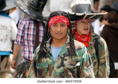 COTACACHI, ECUADOR - JUNE 29, 2016: Inti Raymi, the Quechua solstice festival, with a history of violence in Cotacachi.  Man poses during the dance.
