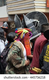 COTACACHI, ECUADOR - JUNE 29, 2016: Inti Raymi, the Quechua solstice celebration, with a history of violence in Cotacachi. Man in a devil mask stomping and dancing.