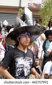 COTACACHI, ECUADOR - JUNE 29, 2016: Inti Raymi, the Quechua solstice celebration, with a history of violence in Cotacachi. Man in a big, black cardboard hat dancing and stomping to wake Mother Earth.