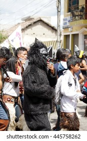 COTACACHI, ECUADOR - JUNE 29, 2016: Inti Raymi, the Quechua solstice celebration, with a history of violence in Cotacachi. Man in a gorilla costume dancing and stomping in the square.