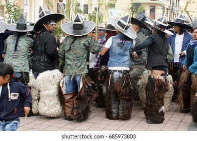 COTACACHI, ECUADOR - JUNE 29, 2017: Men's parade at Inti Raymi, the indigenous solstice festival, with a history of violence in the village