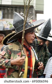 COTACACHI, ECUADOR - JUNE 29, 2017: Men's parade in Inti Raymi, the indigenous seed festival, with a history of violence in the village