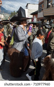 COTACACHI, ECUADOR - JUNE 29, 2017: Men's parade in Inti Raymi, the indigenous solstice festival with a history of violence in the village