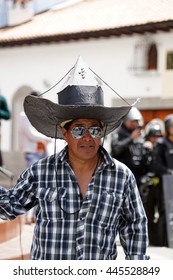 COTACACHI, ECUADOR - JUNE 29, 2106: Inti Raymi, the Quechua solstice celebration, with a history of violence in Cotacachi.  Man with a large black hat dancing.