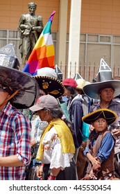 COTACACHI, ECUADOR - JUNE 29, 2106: Inti Raymi, the Quechua solstice celebration, with a history of violence in Cotacachi.  Men stomp and dance under the Quechua flag to wake up Mother Earth.
