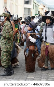 COTACACHI, ECUADOR - JUNE 30, 2016: Inti Raymi, the Quechua solstice festival, with a history of violence in Cotacachi.  Costumed men stomp and dance to awaken Mother Earth.