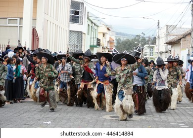 "COTACACHI, ECUADOR - JUNE 30, 2016: Inti Raymi, the Quechua solstice celebration, with a history of violence in Cotacachi.  Men storm into town to ""take the square."""