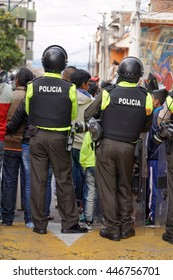 COTACACHI, ECUADOR - JUNE 30, 2016: Inti Raymi, the Quechua solstice festival, with a history of violence in Cotacachi.  Police officers in body armor and riot gear surround the park as a precaution.