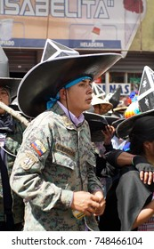 COTACACHI, ECUADOR - JUNE 30, 2017: Men's parade in Inti Raymi, the indigenous solstice festival with a history of violence in the village
