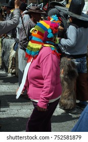 COTACACHI, ECUADOR - JUNE 30, 2017: Woman in a devil mask for Inti Raymi, the indigenous solstice festival, with a history of violence in the village