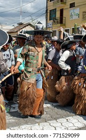 COTACACHI, ECUADOR - JUNE 30, 2017: Men's parade in Inti Raymi, the indigenous solstice festival, with a history of violence in the village