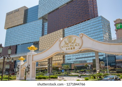 Cotai, Macau, China: September 20, 2018: Exterior of the MGM Macau next to the Wynn Palace entrance sign. The MGM Macau is a 600 room casino hotel resort