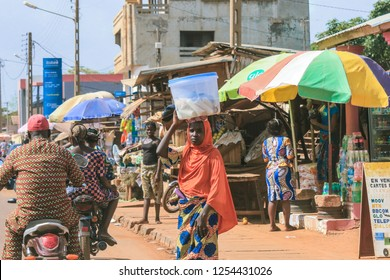 Cotonou, Benin - April 30, 2018: Local African Woman on the Crowded Market