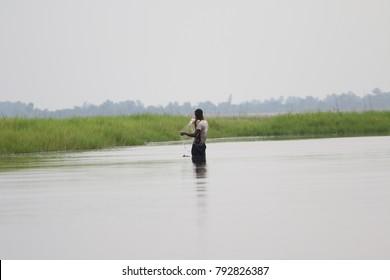 Cotonou Benin February 16 2014 Man is fishing in the lake