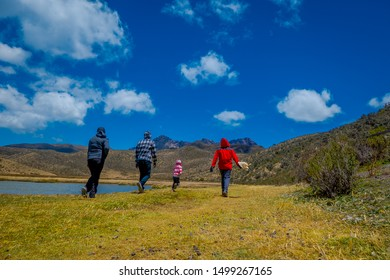 Cotopaxi, ECUADOR - 08 September 2019: Unidentified individuals walking on the Shore of the lake Limpiopungo.