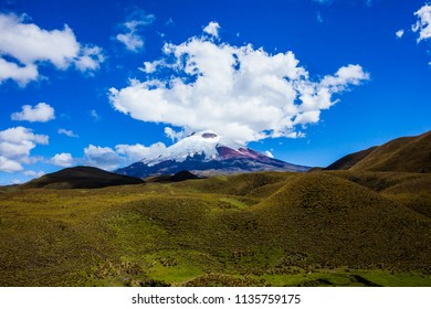 Cotopaxi National Park, the volcano crowned by white clouds and the paramo at its feet.