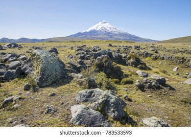 Cotopaxi Volcano, Ecuador with lichen covered boulders thrown out from past eruptions in the foreground. One of the world's highest active volcanoes at 5,897m.