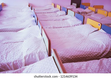 Cots in the kindergarten. orphanage or boarding school. beds in a boarding school or in an orphanage