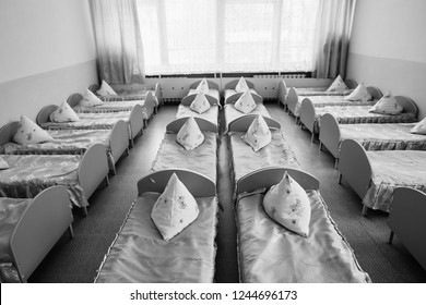 Cots in the kindergarten. Orphanage or boarding school. Beds in a boarding school or in an orphanage.